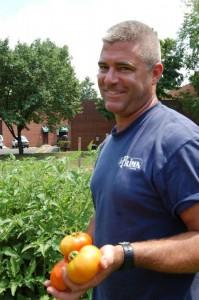 La Prima Chef Kyle Vermeulen in the company's onsite organic garden.